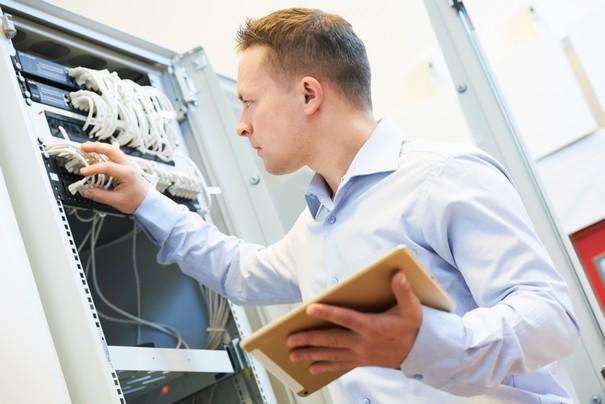 Networking service. network engineer administrator checking server hardware equipment of data center